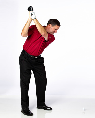 THE DRILL                        Take your driver and place the ball on the ground (or tee it very low) and try to hit some shots. You will soon learn that in order to make solid contact, you need to flatten out the bottom of your swing.                                               CLUBFITTING TIP                         You're actually a good candidate for a high-lofted driver (say 12° or higher). It offers the control of a 3-wood without sacrificing the juice of a driver. The high loft helps to increase launch angle and backspin while reducing sidespin. A large (460cc), forgiving head with the ball teed up a little higher (after you master the drill above) can give more margin of error.