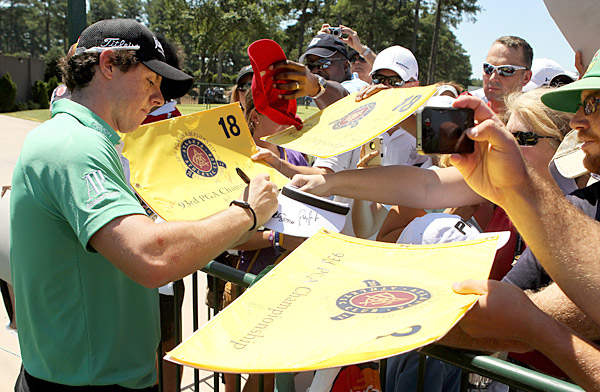 He also took time to sign autographs for fans waiting in the sweltering summer heat.