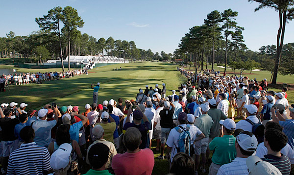Despite the time, fans turned out in droves to watch Woods play.