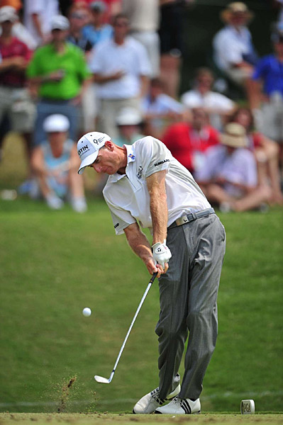 Jim Furyk fired a bogey-free 65 to move within one shot of leaders Jason Dufner and Keegan Bradley.