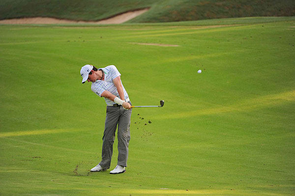 Rory McIlory decided to play on Friday, despite suffering a wrist injury in the first round.