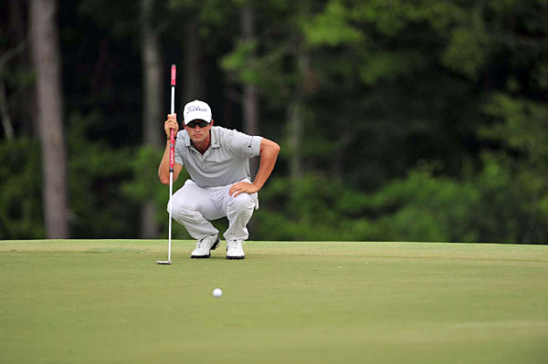Adam Scott shot even par, but he's still in contention at two under.