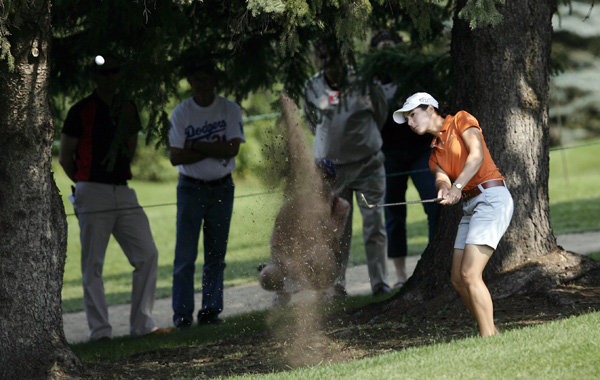 Lorena Ochoa made a par from the trees on the 14th hole. Ochoa shot a bogey-free 65 to move into contention.