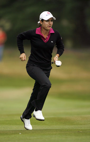 Ochoa ran up the 14th fairway after hitting her approach shot to the par 5. She made a birdie.