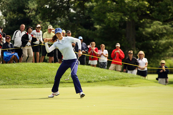 Michelle Wie, who played with Morgan Pressel, had a strong showing in her first match at the Solheim Cup.