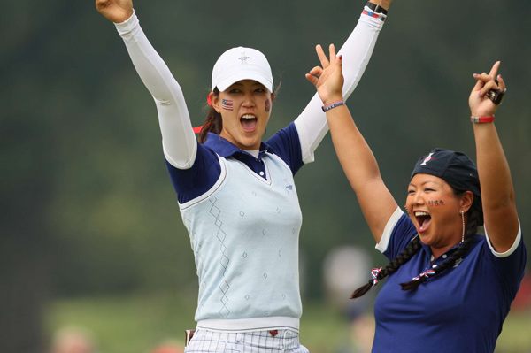 Saturday Morning Four-ball Matches at the 2009 Solheim Cup                                      Michelle Wie (left) and Christina Kim rolled to victory, 5&4 over Helen Alfredsson and Tania Elosegui.
