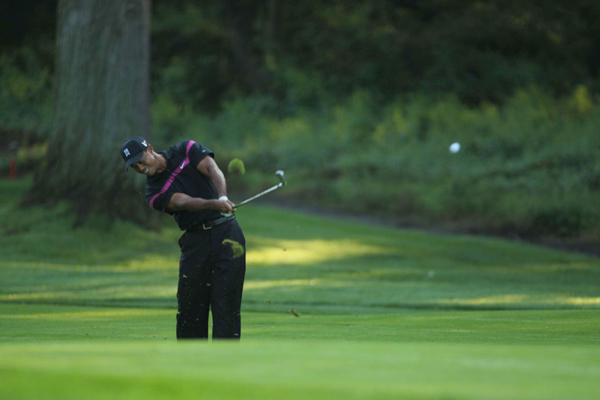 Woods made seven birdies and a bogey in the first round.