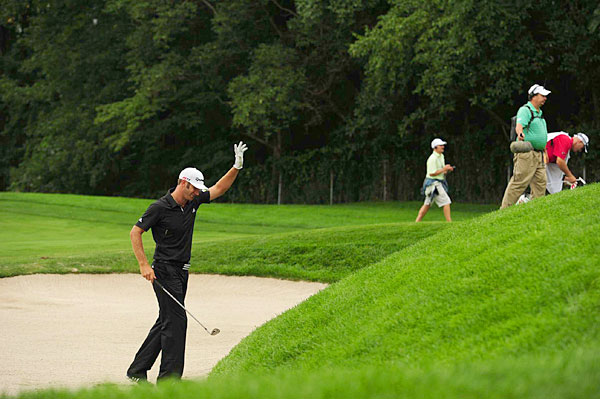 After nearly driving the green on the par-4 fourth, Johnson holed out his bunker shot for eagle.