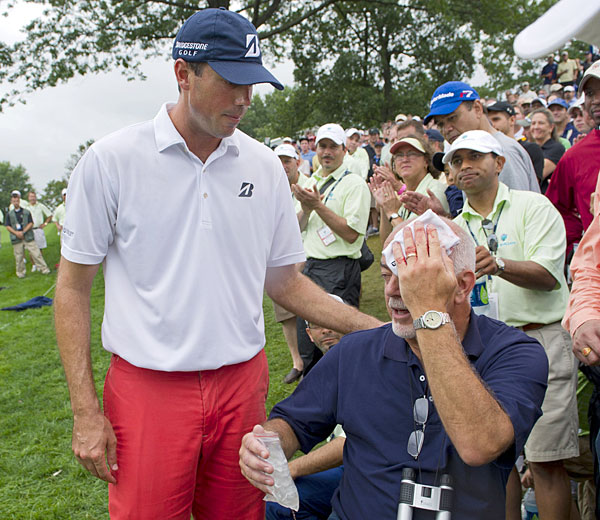 Kuchar checked on a fan after he was hit in the head by Kuchar's tee shot on the 17th hole.