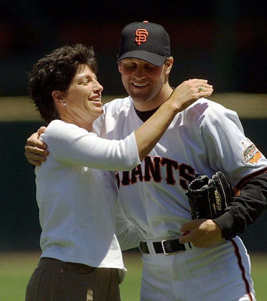 Juli Inkster, the 1999 U.S. Women's Open champ, got a hug from San Francisco Giants pitcher Shawn Estes after throwing out the first pitch at a Giants/Angels game.
