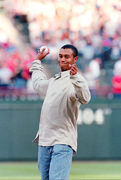 Tiger Woods is a Dodgers fan, but he threw out the first pitch at a Indians/Rangers game while in Texas for the Byron Nelson in May 1997.