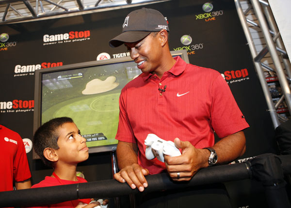 Woods played a round of virtual golf with Ryan Shahadat, 10, of France.