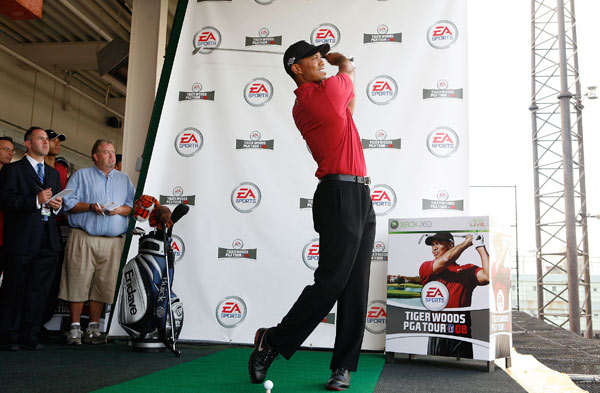 Tiger Woods invades Manhattan                                              Tiger Woods hit golf balls at Chelsea Piers in New York City on Tuesday to celebrate the launch of EA's Tiger Woods PGA Tour 08.