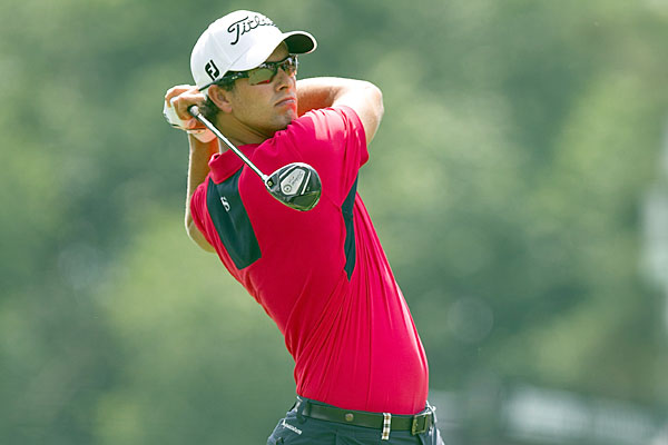 Adam Scott fired an eight-under 62 to grab a one-shot lead.
