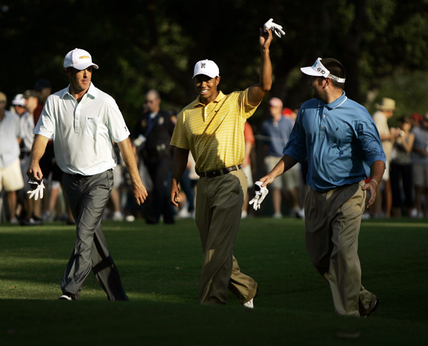 Woods played his practice round with Richard Green of Australia, left, and Bubba Watson.