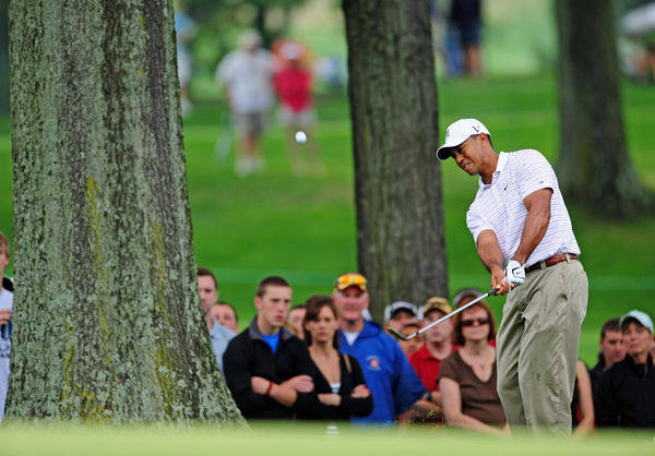 Woods birdied four of the last six holes to move into second place.
