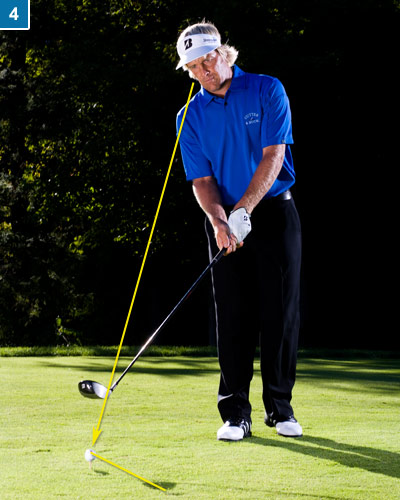 4. Turn your focus to the target line in front of the ball and start walking into your stance from the left. Keep your eyes on the line the whole time.