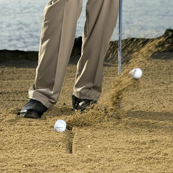 How to Practice It                                              Draw a line in the sand and chip balls off it. Your divot should show the club entering the sand at the back of the line and taking a divot in front of the line. This is not an explosion shot, but you should comb the sand just enough to take a bit of it out of the bunker.