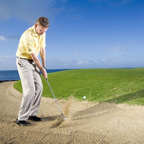 How to Chip From a Trap                       If long bunker shots give you trouble, hit a chip                       By Shaun Humphries                       Top 100 Teachers                                              This story is for you if...                                              • You struggle with long bunker shots.                                              • You'd like a go-to shot from the sand.                                              • You sometimes skull the ball out of the bunker.                                              The Situation                                              You're stuck in a bunker, about 50 feet from the hole. This is a tough shot even for Tour players.                                              The Solution                                              Instead of hitting a long bunker blast (one of the toughest shots you can try), chip the ball out of the bunker. A chip is easier to hit and easier to control once it hits the green, and you don't have to worry about making a big swing and taking the right amount of sand.
