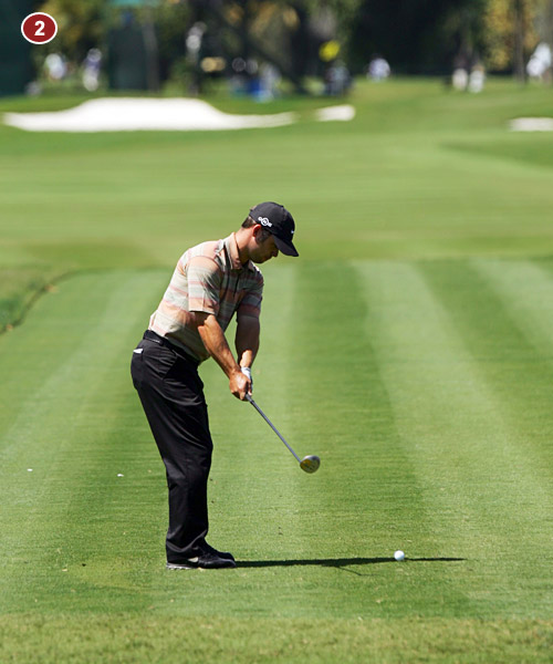 2. See how his shaft angle is already in line with his right forearm? If he were too steep, the shaft would be above his forearm. He gets there by turning his shoulders as his arms swing back.