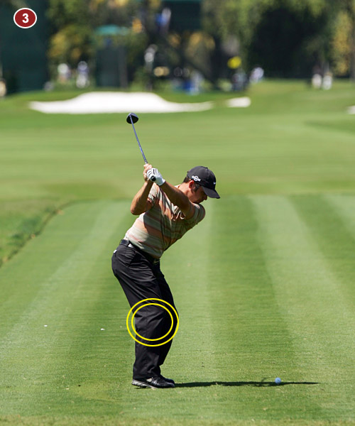 3. At the top, Paul is as perfect as you can get. The clubface is dead square and the underside of his left forearm is even with the top of his shoulder. Look how he's held the flex in his right knee.