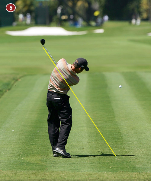 5. Check how the shaft points where the ball used to be. He's created a mirror image of his backswing. When these two positions match, it means you're swinging on plane.