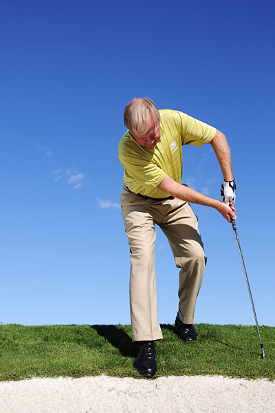A narrow stance with this lie leads to a wobbly, off-balance swing.