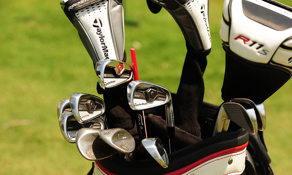 Bob Estes uses TaylorMade Tour Preferred Forged MC irons and Vokey Spin Milled wedges. The iron with a red weight is a TaylorMade Tour Preferred Forged CB.