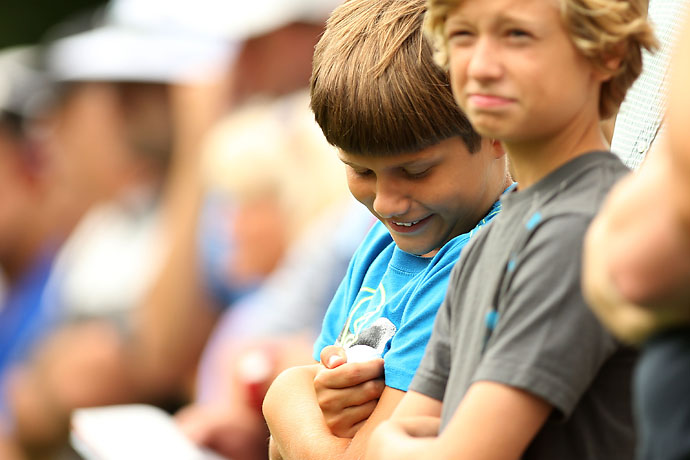 Jackson Ward, 9, of West Orange, N.J., holds a ball rolled to him by Rory McIlroy of Northern Ireland on the fifth tee during the third round of the Barclays on Saturday.