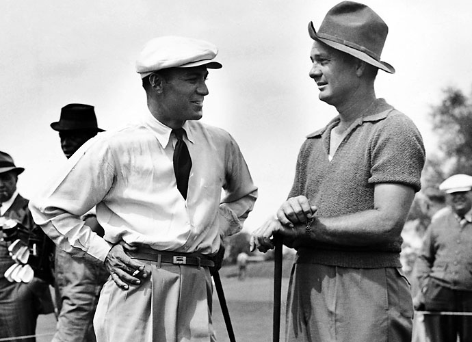 Ben Hogan holds a cigarette as he talks with Jimmy Demaret during a practice round at Augusta National before the 1940 Masters. Demaret, who had won five times in nine starts, shot 67-72-70-71--280 to win the title by four shots over Lloyd Mangrum and collect $1,500. Hogan tied for tenth, 10 shots back.