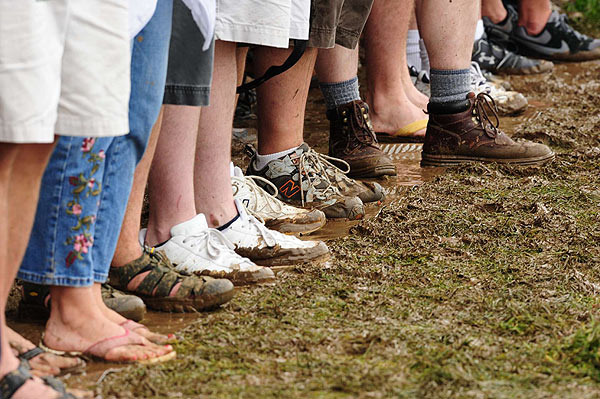 The weather did not keep the fans away, as they trekked across the course in varying footwear.