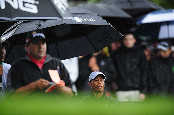 Woods, and his grouping of major winners Angel Cabrera and Padraig Harrington, seemed to draw the unlucky tee times, hitting the course whenever the rain clouds appeared.