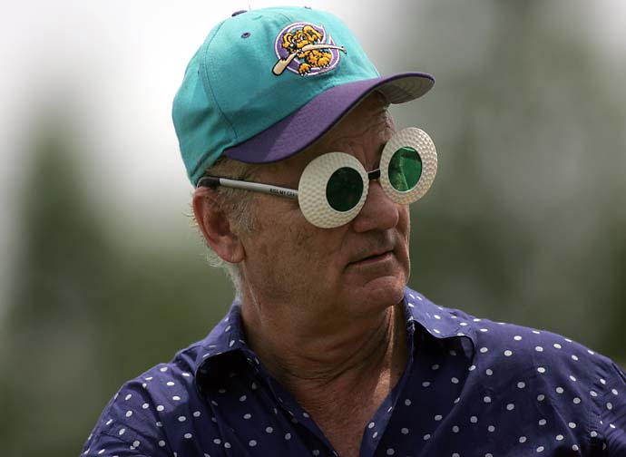 Bill Murray entertains the fans near the 18th tee during the final round of the Outback Steakhouse Pro-Am at the Tournament Players Club in Lutz, Fla., in April 2009.