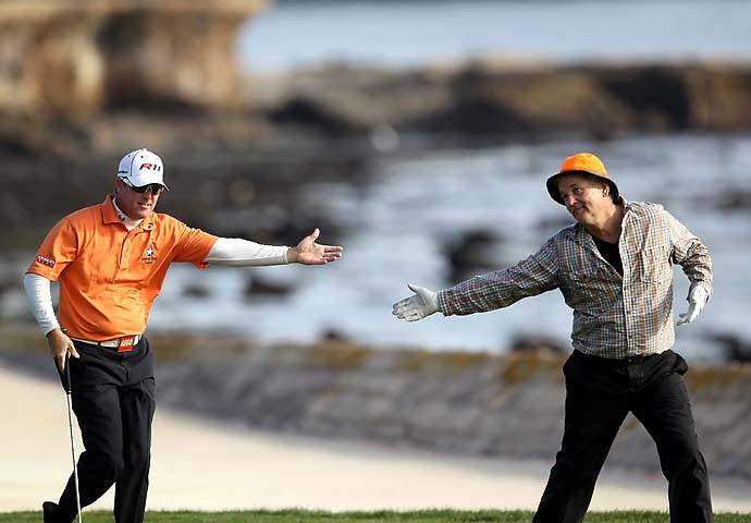 Bill Murray bows to his playing partner and tournament winner, D.A. Points, as they walk up the 18th fairway during the final round of the 2011 AT&T Pebble Beach National Pro-Am at the Pebble Beach Golf Links.