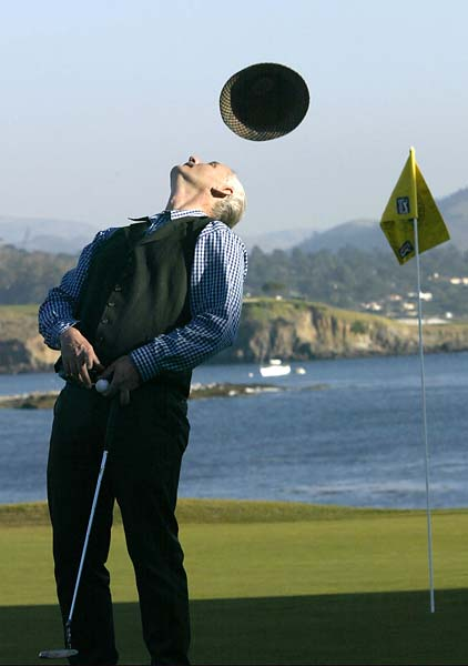 Bill Murray tries to catch his hat on his head after finishing his round on the 18th hole during the third round of the 2002 AT&T Pebble Beach National Pro-Am at Pebble Beach Golf Links. Jonathan Ferrey/Getty Images