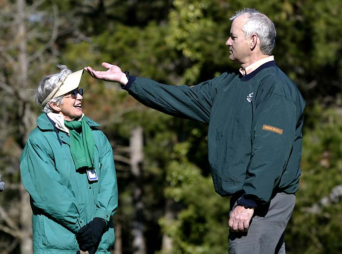 Maybe she slimed him? Bill Murray knocks off 75-year-old Velma Tiffany's visor on the par-4 8th hole at Spyglass Hill during the second round of the 2002 AT&T Pebble Beach National Pro-Am.