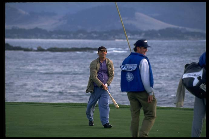 Bill Murray trades his golf club for a baseball bat at Pebble Beach in February 1994.