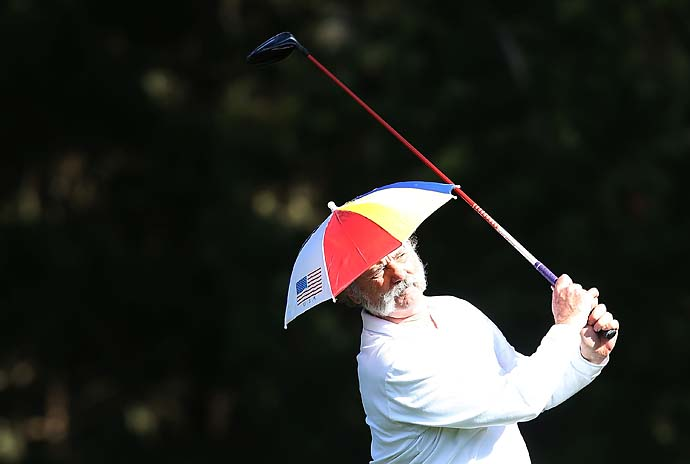 Bill Murray wears an umbrella hat as he hits a tee shot during the second round of the 2013 AT&T Pebble Beach National Pro-Am at Spyglass Hill.