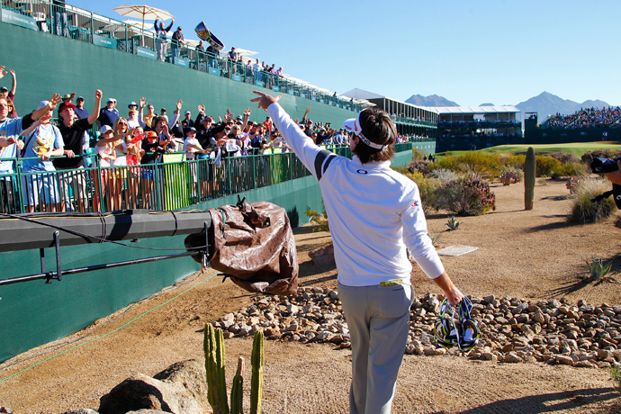Bubba Watson handed out gifts to the fans at the par-3 16th.