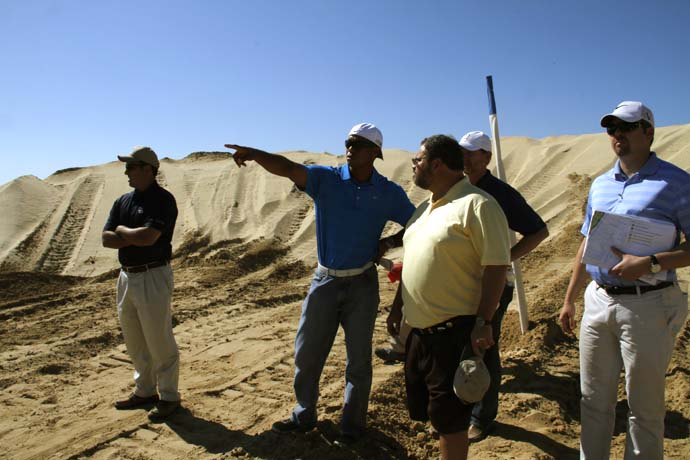 "Tiger Woods gives a tour of the El Cardonal site to Golf Magazine's Joe Passov. ""I like the bunkers to be visible, so we're flashing the faces up,"" Woods says."