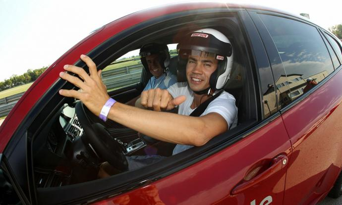 While in Chicago for the 2010 BMW Championship, Camilo Villegas test drove a BMW at the Autobahn Country Club Racetrack.