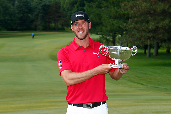 Graham DeLaet of Canada holds the Rivermead Cup as low Canadian winner at the RBC Canadian Open at the Royal Montreal Golf Club on Sunday.