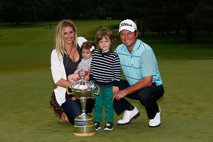Tim Clark of South Africa and his family pose with the trophy after Clark won the RBC Canadian Open at the Royal Montreal Golf Club on Sunday.