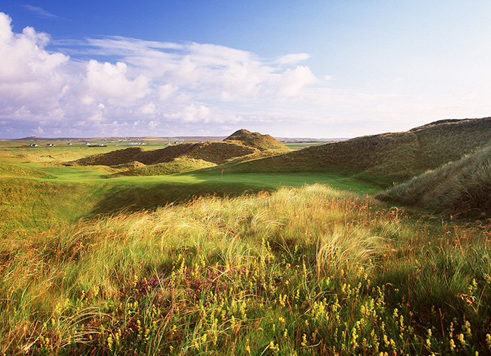 Carne Golf Links, Carne, Belmullet, Co. Mayo: Minimalist Irish architect Eddie Hackett and Mother Nature paired in 1993 to create 18 dramatic holes in westernmost Ireland that deliver striking ocean views, bucking-bronco terrain and elevated greens jabbed into giant sand hills. Twenty years later, the club added an equally stunning third nine, called Kilmore. For those with sturdy legs, this is the Emerald Isle's best value. ($49-$97; 011 353 978 2292, carnegolflinks.com)