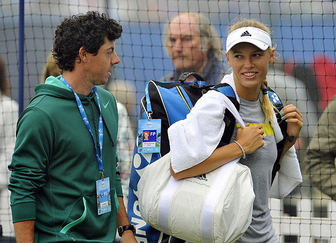 Caroline Wozniacki, who lost in the first round at Wimbledon, was in McIlroy's gallery on Friday.