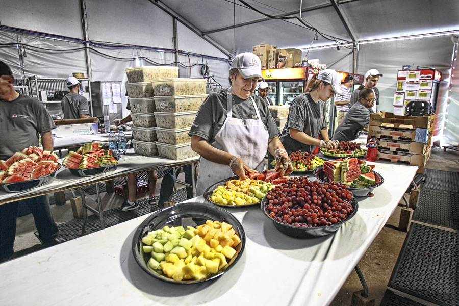 All in a day's work in the catering tent: 888 servings of roasted salmon, 1,200 servings of flank steak, and a whole bunch of fruit platters.