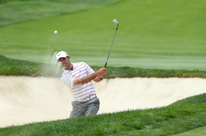 Charl Schwartzel started the day with the lead, but he backed up with a double bogey and two bogeys.