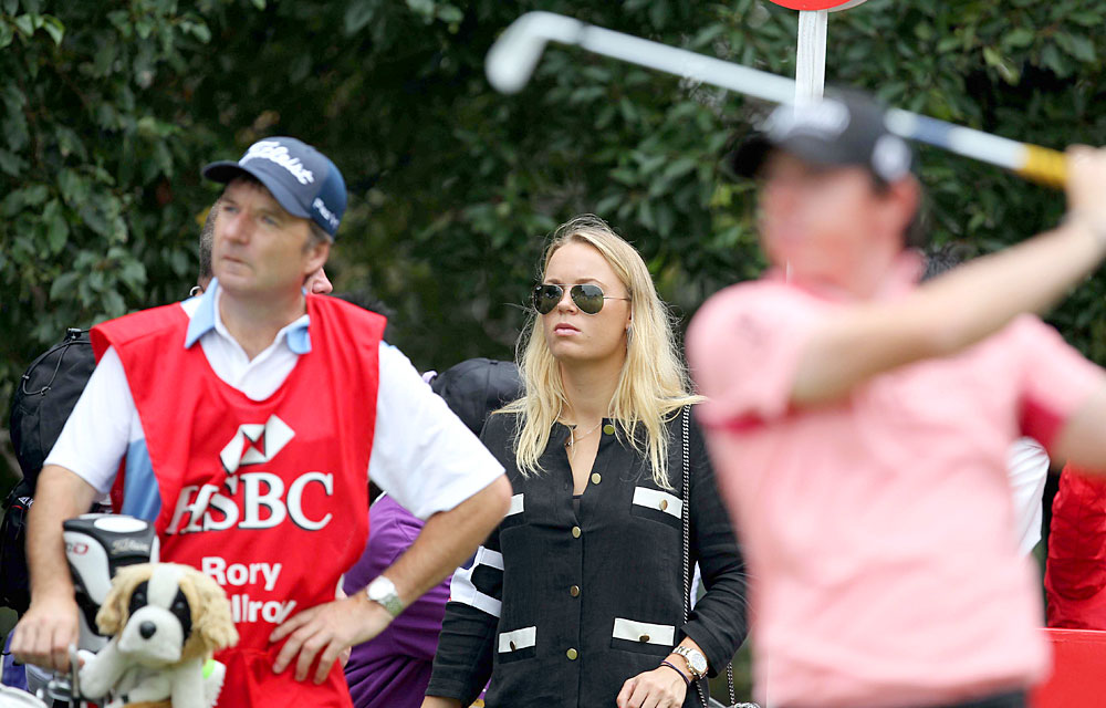 Nov. 4, 2011: Wozniacki slipped inside the ropes to watch McIlroy at the WGC-HSBC Champions in Shanghai.