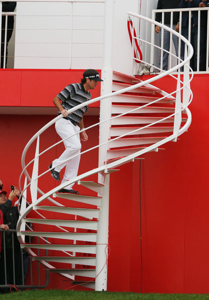 Bubba Watson of the United States climbs a spiral staircase after winning the WGC-HSBC Champions at the Sheshan International Golf Club in Shanghai on Sunday.
