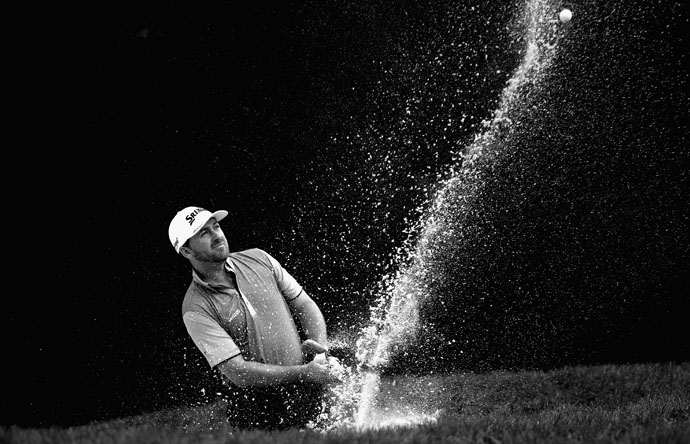 Graeme McDowell plays a bunker shot on the 15th hole during the final round of the WGC-HSBC Champions at the Sheshan International Golf Club Sunday. McDowell misses a 12-foot putt on 18 that would have gotten him into the playoff.